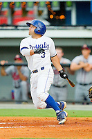 Adrian Morales (3) of the Burlington Royals follows through on his swing against the Danville Braves at Burlington Athletic Park on July 19, 2012 in Burlington, North Carolina.  The Royals defeated the Braves 4-3.  (Brian Westerholt/Four Seam Images)