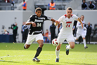 Greg Davis (14) of the Providence Friars and Austin Berry (24) of the Louisville Cardinals go for the ball. The Louisville Cardinals defeated the Providence Friars 3-2 in penalty kicks after playing to a 1-1 tie during the finals of the Big East Men's Soccer Championship at Red Bull Arena in Harrison, NJ, on November 14, 2010.