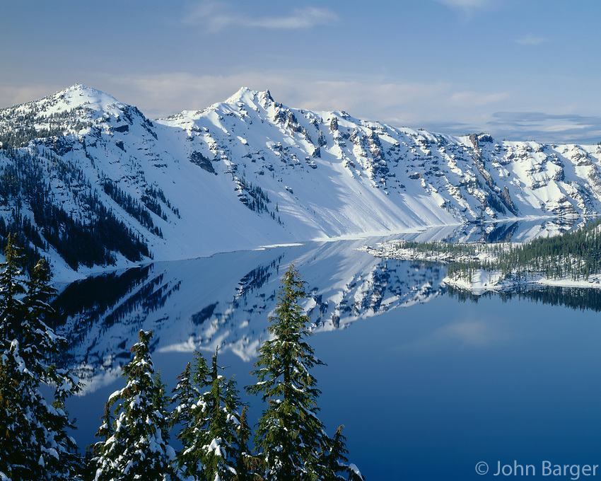 ORCON_013 - USA, Oregon, Crater Lake National Park, Winter snow on west rim of Crater Lake with The Watchman (left) and Hillman Peak (center).