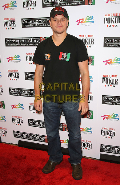 MATT DAMON.4th Annual Ante Up For Africa Tournament at the 2010 World Series of Poker at the Rio All Suite Resort Hotel and Casino, Las Vegas, Nevada, USA..July 3rd, 2010.full length top jeans denim black baseball cap hat .CAP/ADM/MJT.© MJT/AdMedia/Capital Pictures.