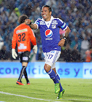 BOGOTA -COLOMBIA- 25-08-2013. Dayro Moreno de Millonarios  celebra su gol  contra el Deportivo Pasto    ,  partido correspondiente a la  sexta fecha de la Liga Postobón segundo semestre disputado en el estadio Nemesio Camacho El Campin     / Millionaires Dayro Moreno celebrates his goal against Deportivo Pasto, game in the sixth round of the second half Postobón League match at the Estadio Nemesio Camacho El Campin . Photo: VizzorImage /Felipe Caicedo  / STAFF