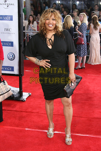 "KYM WHITLEY.""Miami Vice"" World Premiere held at the Mann Village Theater, Westwood, California, USA..July 20th, 2006.Photo: Zach Lipp/AdMedia/Capital Pictures.Ref: ZL/ADM.full length black dress hand on hip clutch purse.www.capitalpictures.com.sales@capitalpictures.com.© Capital Pictures."