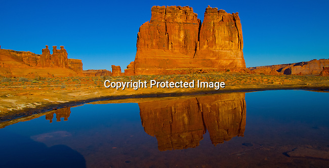 The Three Gossips and the Organ reflected in a pool of water in Arches National Park outside Moab, Utah at Sunset.<br /> Jim Urquhart/straylighteffect.com<br /> 03/12/2010