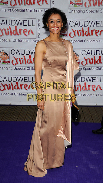 COLIN JACKSON'S WIFE (?).Caudwell Childrens Charity 'Butterfly Ball' at the Battersea Evolution, London, England..May 14th, 2009 .full length pink dress long maxi silk satin beige wrap.CAP/CAN.©Can Nguyen/Capital Pictures.