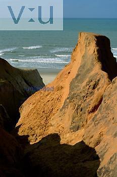 Eroded sandy cliffs at Morro Branco Beach, Atlantic coast, Ceara, Brazil.