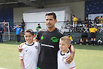 "Fans pose with All My Children's Mark Consuelos participates at the ""Kicking It"" at the Annual Tribeca/NYFEST Soccer Day Celebrity Exhibition on April 21, 2012 - NYFEST (which stands for New York Film and Entertainment Soccer Tournament) was designed to mesh the worlds of entertainment, soccer and New York City in conjunction with the Tribeca Film Festival. The day included a film and entertainment industry tournament with 44 teams with one winner the Grassrootsoccer team which Mark Consuelos played on was cofounded by Survivor winner Ethan Zohn. The all-day event took place at Pier 40 in Manhattan, and consisted of an industry tournament, a youth showcase, and a celebrity soccer tournament.  (Photo by Sue Coflin/Max Photos)"