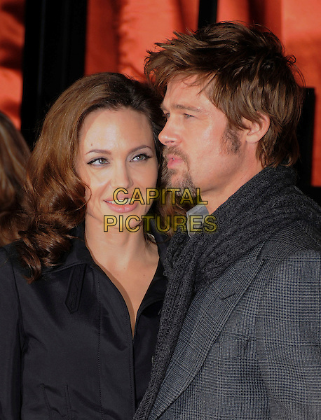 ANGELINA JOLIE & BRAD PITT.At The 13th Annual Critics Choice Awards held at The Santa Monica Convention Center in Santa Monica, California, USA, January 07 2008.                                                                    portrait headshot couple black grey jacket beard scarf smiling Brad's profile.CAP/DVS.©Debbie VanStory/Capital Pictures