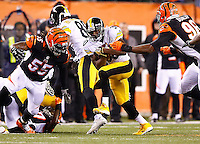 Jordan Todman #30 of the Pittsburgh Steelers carries the ball through the Cincinnati Bengals defense during the Wild Card playoff game at Paul Brown Stadium on January 9, 2016 in Cincinnati, Ohio. (Photo by Jared Wickerham/DKPittsburghSports)