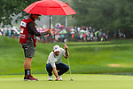 CROMWELL, CT. 21 June 2019-062119 - PGA Tour player Paul Casey lines up his birdie putt on the par 3 eighth hole as his caddie holds an umbrella shielding him from the rain,  during the second round of the Travelers Championship at the TPC River Highlands in Cromwell on Thursday. Bill Shettle Republican-American