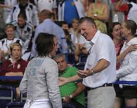 European Championships Fencing 2010 / Fecht Europameisterschaft 2010 in Leipzig - Competition Championat d'europe - im Bild: Sibylle Klemm (GER, Women Sabre / Damen Säbel ) after winning her match in quart finale with DFB sport director Manfred Kaspar (r.) Foto: Norman Rembarz..Norman Rembarz , Autorennummer 41043728 , Augustenstr. 2, 04317 Leipzig, Tel.: 01794887569, Hypovereinsbank: BLZ: 86020086, KN: 357889472, St.Nr.: 231/261/06432 - Jegliche kommerzielle Nutzung ist honorar- und mehrwertsteuerpflichtig! Persönlichkeitsrechte sind zu wahren. Es wird keine Haftung übernommen bei Verletzung von Rechten Dritter. Autoren-Nennung gem. §13 UrhGes. wird verlangt. Weitergabe an Dritte nur nach  vorheriger Absprache..