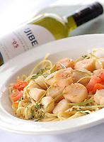"Scallops Sauted over Linguini, New Bedford Scallops in Garlic, Leeks, Chopped Tomato, White Wine. White Wine: ""JIBE"" New Zealand Savignaugh Blanc"