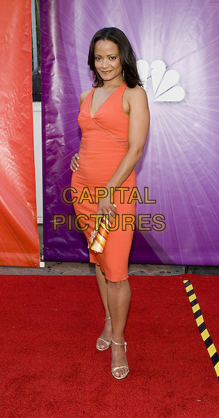 JUDY REYES.Network All Star Celebration held at the Century Club, .Los Angeles, 25th July 2005.full length full-length orange fitted tight dress yellow stripe clutch bag gold strappy sandals.www.capitalpictures.com.sales@capitalpictures.com.© Capital Pictures.