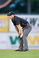 Third base umpire Alberto Ruiz during the Pacific Coast League game between the Oklahoma City RedHawks and the Nashville Sounds at Greer Stadium on July 25, 2014 in Nashville, Tennessee.  The Sounds defeated the RedHawks 2-0.  (Brian Westerholt/Four Seam Images)