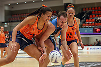 All Stars Aliyah Dunn and Whitney Souness sandwich NZ Men's Daniel Rich during the Cadbury Netball Series match between NZ Men and All Stars at the Bruce Pullman Arena in Papakura, New Zealand on Friday, 28 June 2019. Photo: Dave Lintott / lintottphoto.co.nz