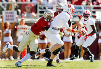 TALLAHASSEE, FL 10/29/11-FSU-NCST102911 CH-Florida State's Christian Jones forces N. C. State quarterback Mike Glennon to fumble during second half action Saturday at Doak Campbell Stadium in Tallahassee. FSU recovered the ball. The Seminoles shut out the Wolfpack 34-0..COLIN HACKLEY PHOTO