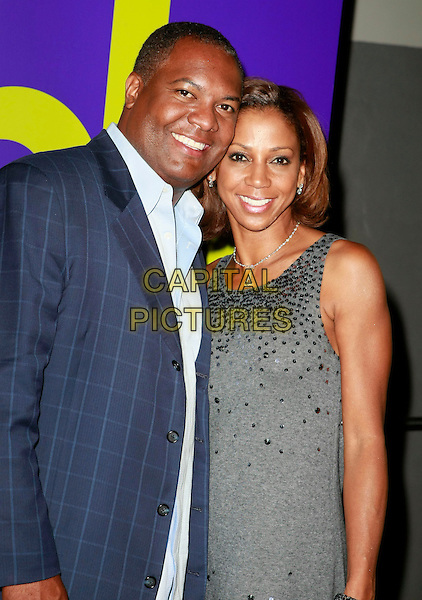RODNEY PEETE & HOLLY ROBINSON PEETE.Planet Hollywood Resort & Casino Grand Opening - Day 2 held at the Planet Hollywood Resort & Casino, Las Vegas, Nevada, USA..November 17th, 2007 .half length blue suit jacket grey gray dress sequins sequined dress married husband wife .CAP/ADM/MJT.©MJT/AdMedia/Capital Pictures.