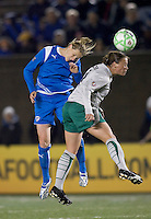 Boston Breakers forward-midfielder Kelly Smith (10) and St Louis Athletica midfielder Lisa Stoia (7) battle for head ball. The Boston Breakers defeated Saint Louis Athletica, 2-0, at Harvard Stadium on April 11, 2009.