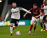 Wayne Rooney of Derby County gets past Paul Anderson of Northampton during the FA Cup match at the Pride Park Stadium, Derby. Picture date: 4th February 2020. Picture credit should read: Darren Staples/Sportimage