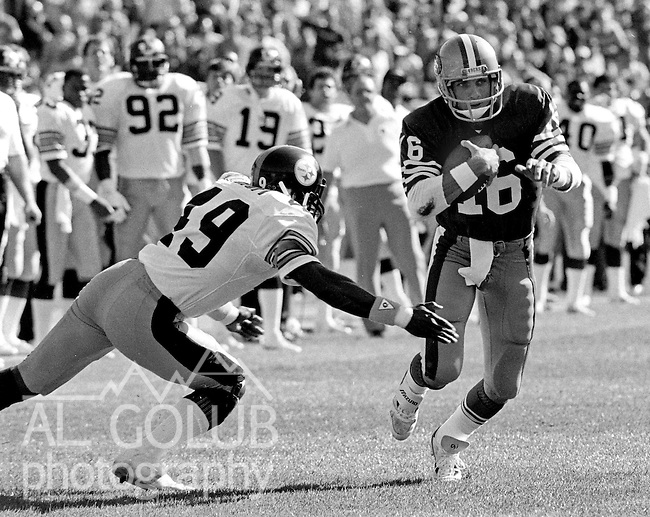 San Francisco 49ers vs. Pittsburgh Steelers at Candlestick Park Sunday, October 14, 1984..Steelers beat the 49ers 20-17.Pittsburgh Steelers Defensive back Dwayne Woodruff (49) attempts to tackle San Francisco Quarterback Joe Montana (16)...