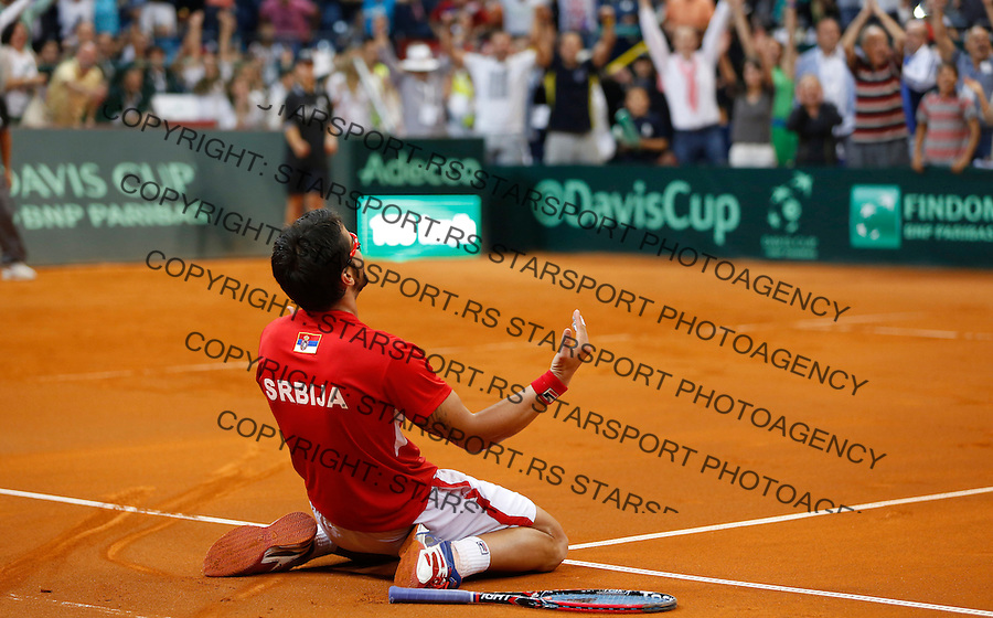 Tennis Tenis<br /> Davis Cup semifinal polufinale<br /> Serbia v Canada<br /> Janko Tipsarevic v Vasek Pospisil<br /> Janko Tipsarevic (C) celebrate victory <br /> Beograd, 15.09.2013.<br /> foto: Srdjan Stevanovic/Starsportphoto &copy;