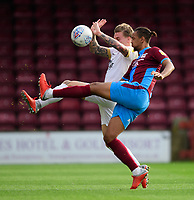 Scunthorpe United's Cameron Borthwick-Jackson vies for possession with Peterborough United's Jason Cummings<br /> <br /> Photographer Chris Vaughan/CameraSport<br /> <br /> The EFL Sky Bet League One - Scunthorpe United v Peterborough United - Saturday 13th October 2018 - Glanford Park - Scunthorpe<br /> <br /> World Copyright &copy; 2018 CameraSport. All rights reserved. 43 Linden Ave. Countesthorpe. Leicester. England. LE8 5PG - Tel: +44 (0) 116 277 4147 - admin@camerasport.com - www.camerasport.com