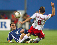 Jeff Agoos tackles the ball. The USA lost 3-1 against Poland in the FIFA World Cup 2002 in Korea on June 14, 2002.