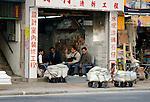Hong Kong urban scene - men sitting in shop talking