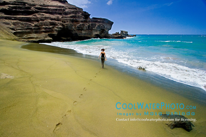 Woman tourist walking on Green Sand Beach, Mahana Bay, South Point, Big Island, Hawaii, Pacific Ocean