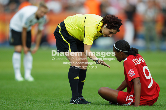 BERLIN - JUNE 26:  Referee Jacqui Melksham (AUS) encourages Candace Chapman of Canada to resume play during the opening match of the FIFA Women's World Cup soccer tournament between Canada and Germany at Olympiastadion on June 26, 2011 in Berlin, Germany.  Editorial use only.  No pushing to mobile device usage.  Commercial use prohibited.  (Photograph by Jonathan Paul Larsen)