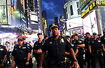 NEW YORK, NY - JULY 07: Police watch activists protest in Times Square in response to the recent fatal shootings of two black men by police, July 7, 2016 in New York City. Protests and public outcry have grown in the days following the deaths of Alton Sterling on July 5, 2016 in Baton Rouge, Louisiana and Philando Castile on July 6, 2016, in Falcon Heights, Minnesota. (Photo by Yana Paskova/Getty Images)