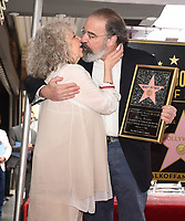 HOLLYWOOD - FEBRUARY 12: Mandy Patinkin and wife Kathryn Grody as Mandy Patinkin was honored with a star on the Hollywood Walk of Fame today, where Homeland's Rupert Friend and broadway legend Patti LuPone spoke to his storied career and humanitarian work.The ceremony was followed by a celebratory luncheon given by Fox 21 Television Studios and Showtime.  Homeland's seventh season premiered on Showtime February 11, and airs Sundays at 10 PM. (Photo by Frank Micelotta/FOX/PictureGroup)