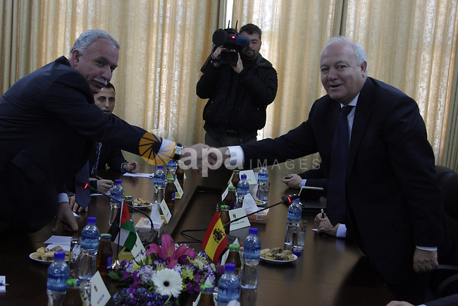 Palestinian Foreign Minister Riyad al-Malki (L) and Spanish Foreign Minister Miguel Angel Moratinos, whose country currently holds the rotating EU presidency, during a meeting in the West Bank city of Ramallah on February 2, 2010. Moratinos, who is scheduled to meet with Israeli Premier Benjamin Netanyahu later in the day, is on a Middle East regional tour that will also take him to Syria. Photo by Issam Rimawi