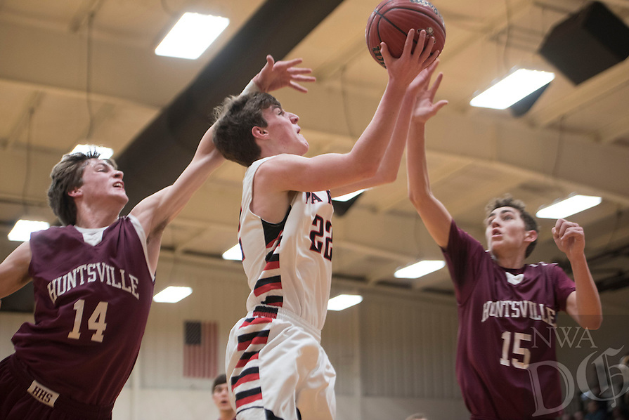 NWA Democrat-Gazette/J.T. WAMPLER  Pea Ridge's Hayden Holtgrewe takes a shot while Huntsville's Jack Eaton (14) and Alex Pemberton defend Tuesday Feb. 9, 2016. Huntsville won 50-42. For more images from the game go to http://nwamedia.photoshelter.com/