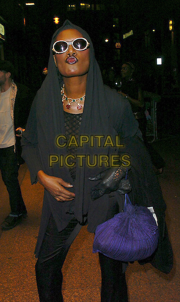 GRACE JONES.The Times BFI London Film Festival: The Proposition - MTV gala.October 26th, 2005.Ref: CAN.half length sunglasses shades kiss gesture funny glove black jacket.www.capitalpictures.com.sales@capitalpictures.com.©Capital Pictures