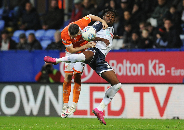 Bolton Wanderers' Joe Dodoo vies for possession with Blackpool's James Husband<br /> <br /> Photographer Kevin Barnes/CameraSport<br /> <br /> The EFL Sky Bet League One - Bolton Wanderers v Blackpool - Monday 7th October 2019 - University of Bolton Stadium - Bolton<br /> <br /> World Copyright © 2019 CameraSport. All rights reserved. 43 Linden Ave. Countesthorpe. Leicester. England. LE8 5PG - Tel: +44 (0) 116 277 4147 - admin@camerasport.com - www.camerasport.com