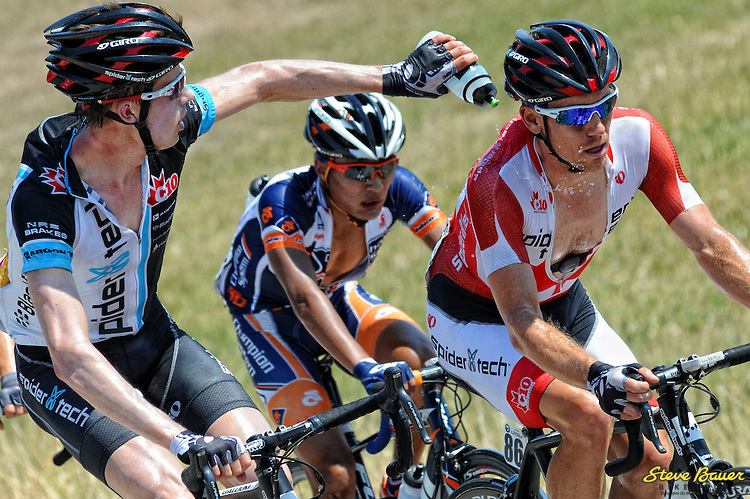 Will Routley helps Ryan Roth stay cool during Stage 1 of the Larry H. Miller Tour of Utah. Aug. 7, 2012. Photo by Brian Hodes/VeloImages