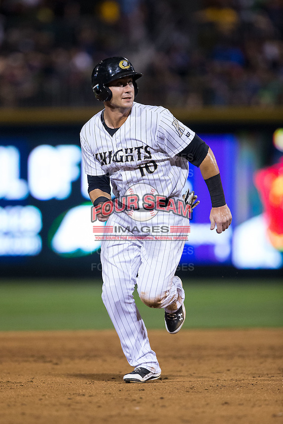 Nicky Delmonico (10) of the Charlotte Knights hustles towards third base against the Lehigh Valley Iron Pigs at BB&T BallPark on June 3, 2016 in Charlotte, North Carolina.  The Iron Pigs defeated the Knights 6-4.  (Brian Westerholt/Four Seam Images)
