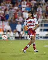 FC Dallas midfielder Juan Toja (8) passes the ball.  New England Revolution defeated FC Dallas 3-2 to capture the 2007 Lamar Hunt U.S. Open Cup at Pizza Hut Park in Frisco, TX on October 3, 2007.