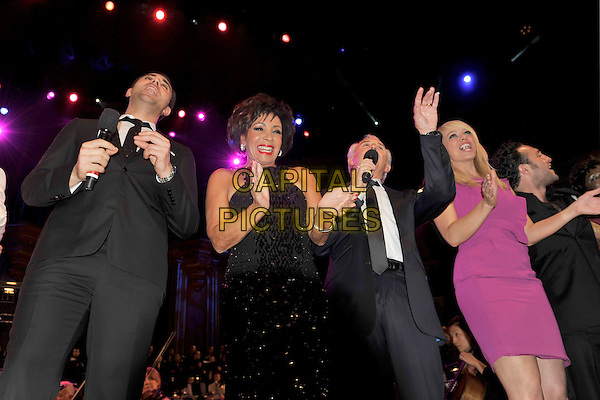 DARIUS CAMPBELL, DAME SHIRLEY BASSEY, TONY CHRISTIE, LIZ McCLARNON.The Beatles Philharmonic Tribute at the Royal Albert Hall, London, England..October 28th, 2010.stage concert live gig performance music half length black dress paillettes hands clapping purple dress suit jacket danesh.CAP/MAR.© Martin Harris/Capital Pictures.