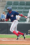 Greenville right fielder Luis Soto follows through on his swing versus Kannapolis at Fieldcrest Canon Stadium in Kannapolis, NC, Sunday, July 9, 2006.  The Drive defeated the Intimidators 14-9.