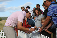 Peter Uihlein (USA) signs autograph for fans following his superb -4 par round to lead on -7 post Round Three at the 2013 ISPS Handa Wales Open from the Celtic Manor Resort, Newport, Wales. Picture:  David Lloyd / www.golffile.ie