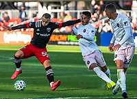 WASHINGTON, DC - MARCH 07: Eric Sorga #50 holds off Nicolás Figal #5 of Inter Miami during a game between Inter Miami CF and D.C. United at Audi Field on March 07, 2020 in Washington, DC.
