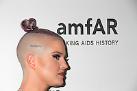 NEW YORK, NY - JUNE 21: Showing off her new 'Solidarity' head tattoo, Kelly Osbourne attends amfAR generationCURE 5th Annual SOLSTICE event in New York, New York on June 21, 2016.  Photo Credit: Rainmaker Photo/MediaPunch