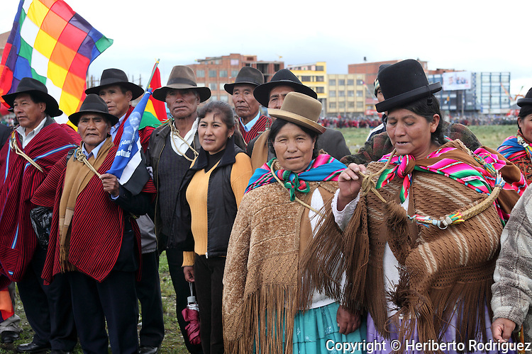 Native Bolivian peasants check assistance of their communities as they attend the ceremony of the New Constitution of Bolivia signed by President Evo Morales at El Alto, in the surroundings of La Paz, February 7, 2009. The new Constitution marks a new relationship between the Indian people, their communal justice, regional autonomy, and respecting their cultures. Photo by Heriberto Rodriguez