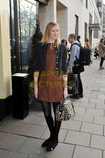 Jade Parfitt.attending the Temperley London a/w 2013 catwalk show, Dorchester Hotel, London, England. .17th February 2013.London Fashion Week LFW full length black jeans denim jacket brown dress leopard print bag purse beige tights.CAP/MAR.© Martin Harris/Capital Pictures.