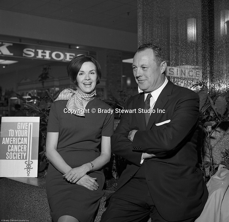 Pittsburgh PA: View of Jim Daniell and a volunteer at the American Cancer Society Benefit at the new Allegheny Center Mall on the North Side of Pittsburgh - 1966.  The Daniell Sapp and Boorn agency put on the event to benefit the American Cancer Society and the new Allegheny Center Mall.  The mall recently opened and extra publicity is always a good thing.  Daniell Sapp and Boorn which opened in 1962, was active in helping good causes which indirectly promoted their insurance services. During the 1950's and 1960's local corporations and companies were very active in supporting non-profit and charitable organizations.