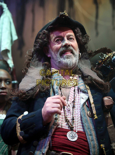 "KEITH ALLEN.Stars as Long John Silver in The Theatre Royal, Haymarket production of ""Treasure Island"" adapted from Robert Louis Stevenson's classic novel..London, England, November 14th 2008.play scene costume character half length beard facial hair pirate hat tongue funny on stage .CAP/DS.©Dudley Smith/Capital Pictures"