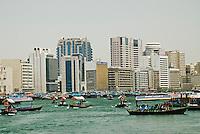 United Arab Emirates, Dubai, Deira skyline and abra ferries on Dubai Creek
