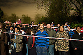 Local residents watch a fireworks display, organised by Queen's Park Neighbourhood Forum. on Guy Fawkes night.  Queen's Park Gardens, London.