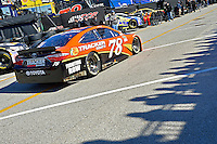 13-21 February, 2016, Daytona Beach, Florida USA<br /> As the shadows of fans atop the Sprint Fandeck fall across the pavement in the garage area the car of Martin Truex Jr, Furniture Row Toyota Camry rolls back to his garage stall.<br /> ©2016, F. Peirce Williams